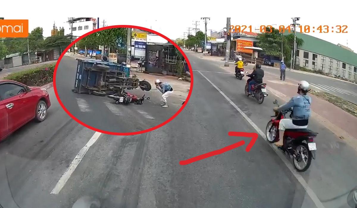 Em gái chạy Satria vượt đèn đỏ tông lật xe ba gác ở Bến Cát